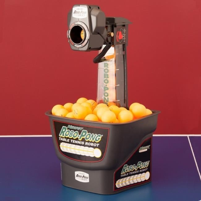 Place The Newgy Robo-Pong 540 Robot On The Table Tennis Table